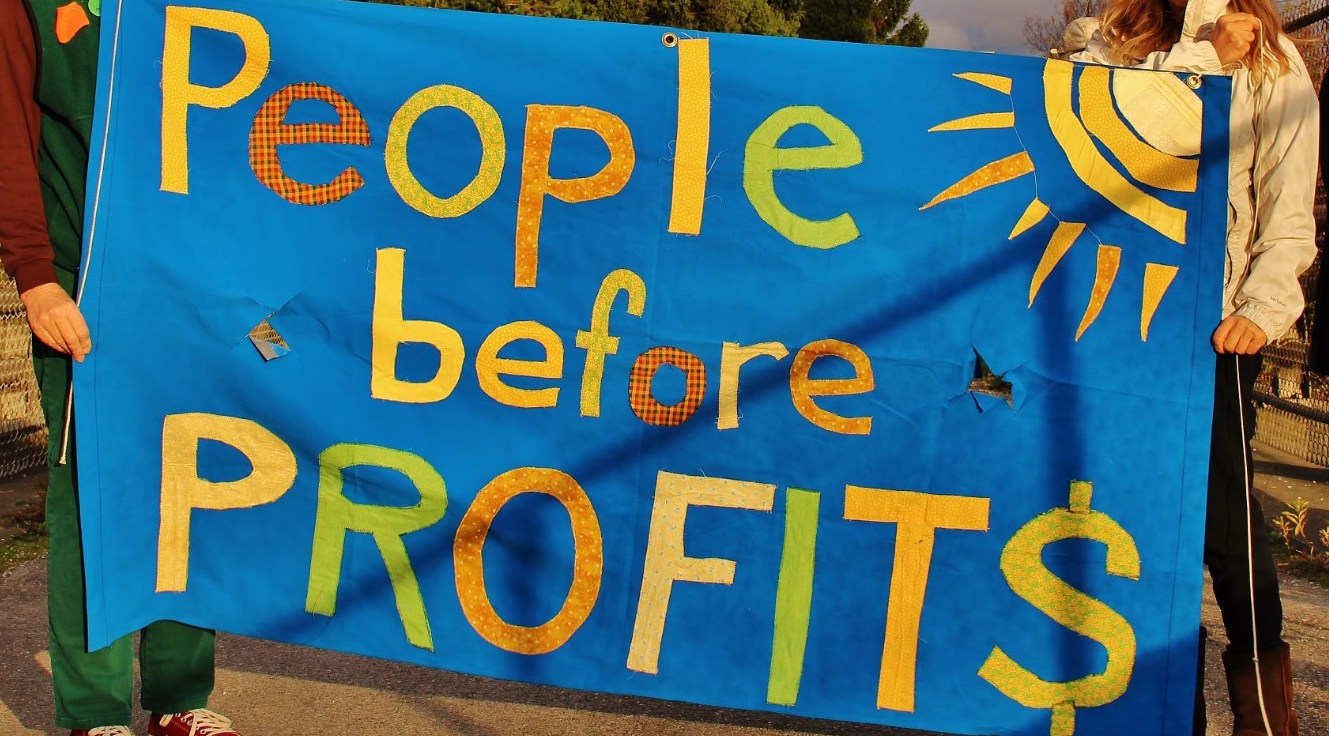 people before profits sign